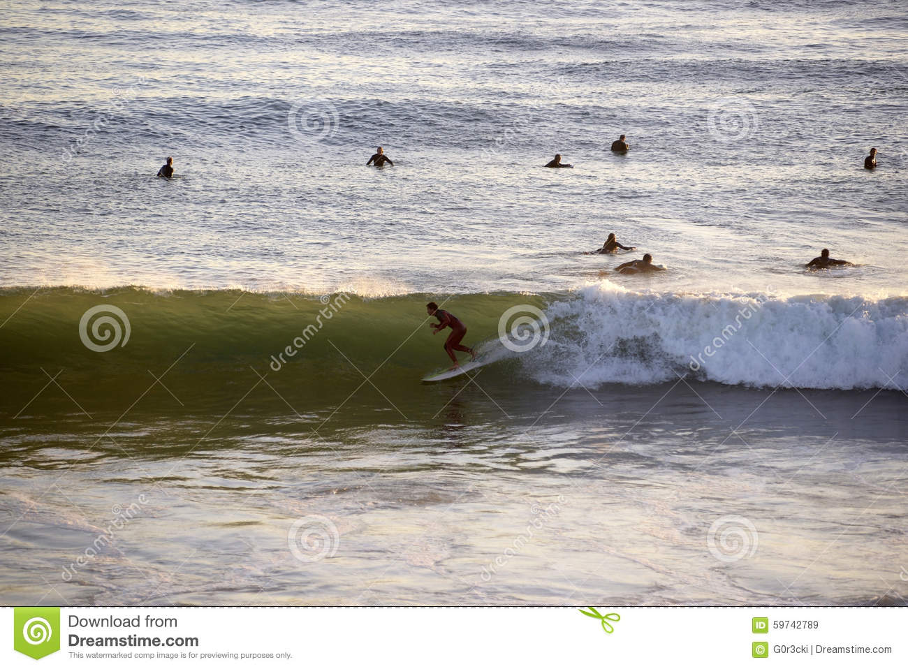 Picture of surfers entering the water.